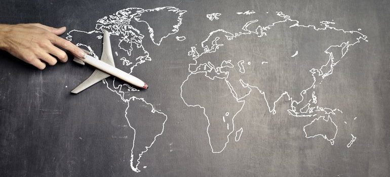 Model plane on a drawn world map.