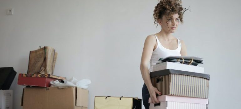 A woman carrying boxes